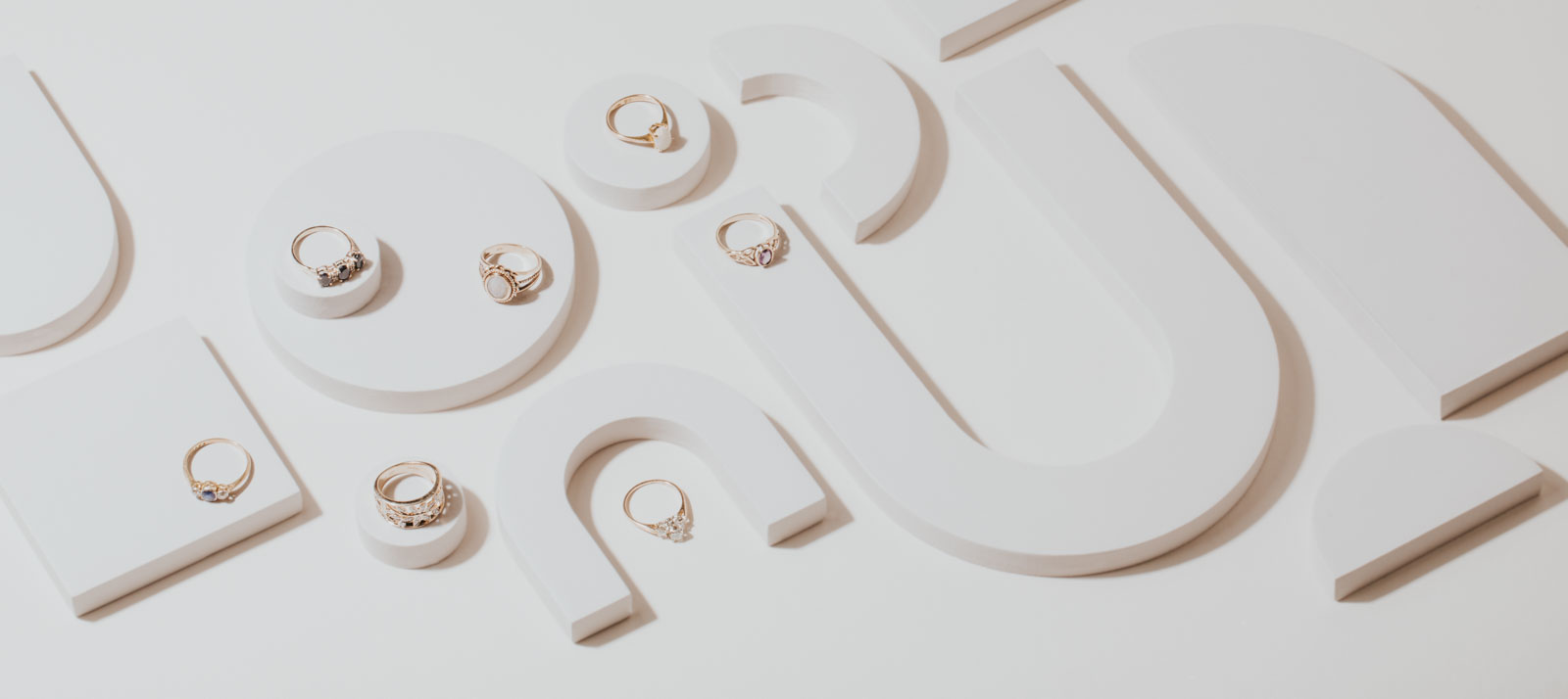 All white creative layflat professional photography for jewelry