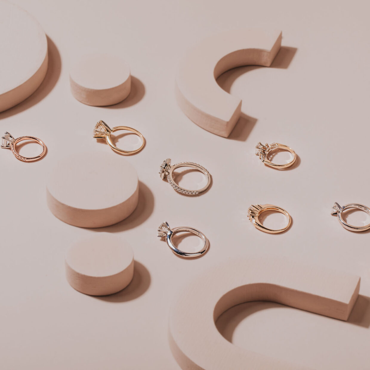Professional and creative layflat ideas for photographing jewelry and diamond engagement rings. Tiffany's, Birks and Cartier rings. Creative use of coloured blocks to add fun to the layflat styling