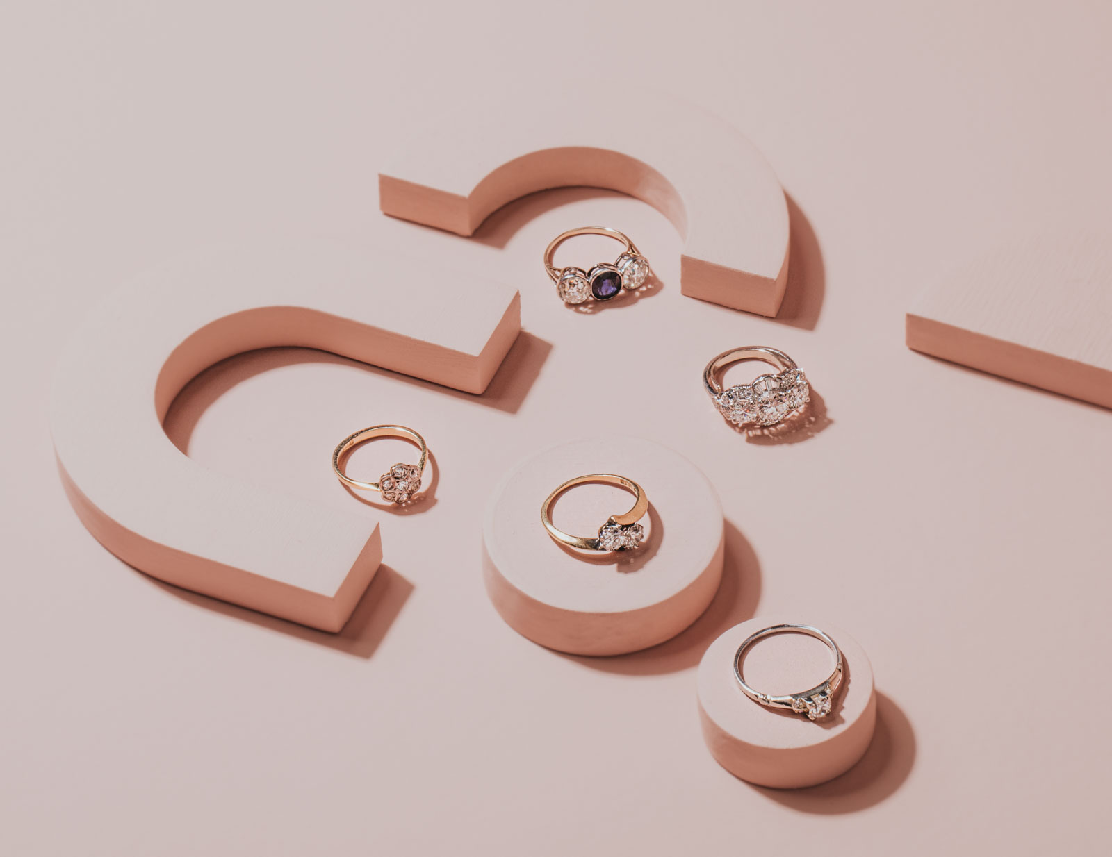 Creative layflat jewelry setup for product photography of gold and silver diamond rings for 100 Ways Jewelry. Light pink and blush blocks for unique and fun product shots