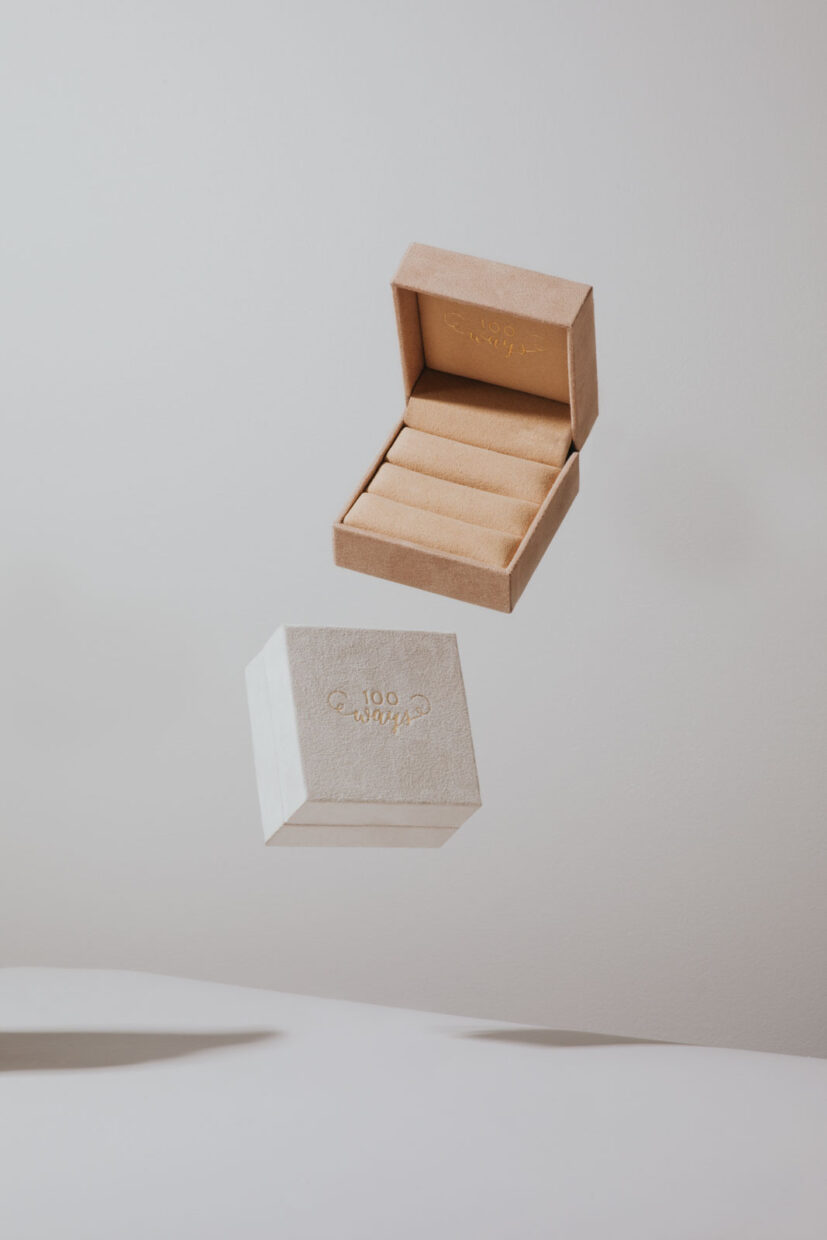 Creative product photography of jewelry boxes, one blush and one white. 100 Ways Jewelry velvet jewelry boxes. Commercial product photography by Cat and Jeff Chang of The Apartment Creative
