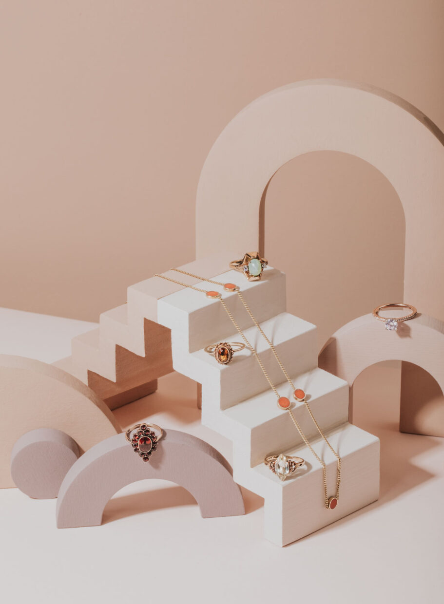 Quirky, fun and unique product photography for jewelry. Pink, white and peach tones for a modern take on product photography